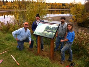 Interior Alaska Land Trust board members show off an interpretive signs at the mouth of Cripple Creek in Fairbanks. Photo- Sam Dashevsky