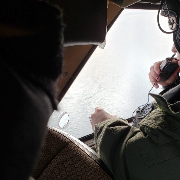 Washington Department of Fish and Wildlife aerial survey observer recording counts of all marine birds and mammals seen along transects flown over Washington's waters of the Salish Sea.<br>Joseph R. Evenson, Washington Department of Fish and Wildlife